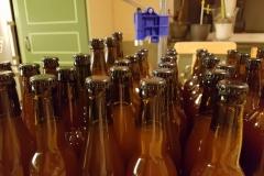 Flaskor och kapsylapparat